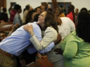 Sen. Kamala Harris, D-Calif., meets people before a Corinthian Baptist Church service, Sunday, Aug. 11, 2019, in Des Moines, Iowa. Harris, tapped on Tuesday, Aug. 11, 2020 as Joe Biden's running mate, attended services at both a Black Baptist church and a Hindu temple growing up.