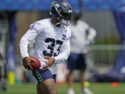 Seattle Seahawks safety Jamal Adams holds the football during a practice drill at NFL football training camp, Wednesday, Aug. 12, 2020, in Renton, Wash. (AP Photo/Ted S.