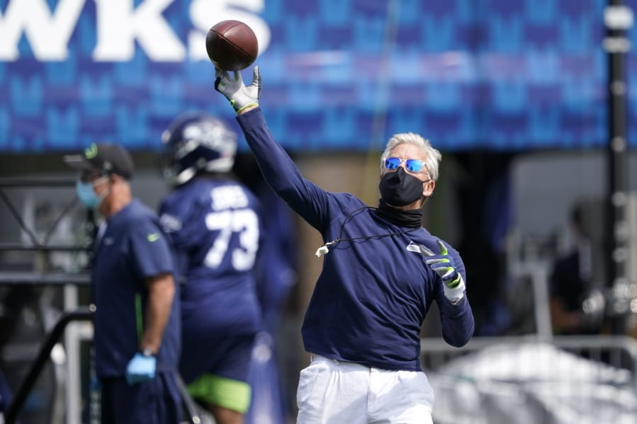 Seattle Seahawks head coach Pete Carroll throws a football during NFL football training camp, Wednesday, Aug. 12, 2020, in Renton, Wash. (AP Photo/Ted S.