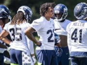 Seahawks cornerback Quinton Dunbar, center, stands at training camp in Renton. Though not revealing specifics, Dunbar spoke vaguely about an offseason arrest in Florida for alleged armed robbery. Those charges were dropped.
