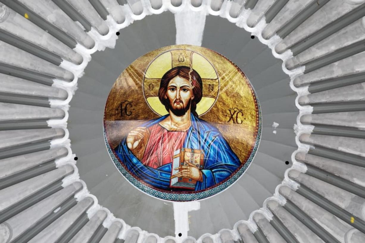 An image of Christ is in place in the ceiling of the St. Nicholas Greek Orthodox Church, Monday, Aug. 3, 2020 at the World Trade Center in New York. The original church was destroyed in the attacks of Sept. 11, 2001. The shrine is expected to open in 2021.