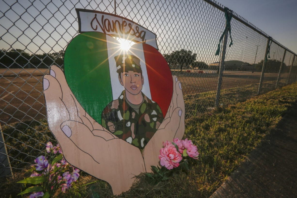 A small memorial for U.S. Army Specialist Vanessa Guillen is set up around Cesar Chavez High School Friday, Aug. 14, 2020, in Houston.  Investigators said Guillen was bludgeoned to death on base by a fellow soldier, who later killed himself.