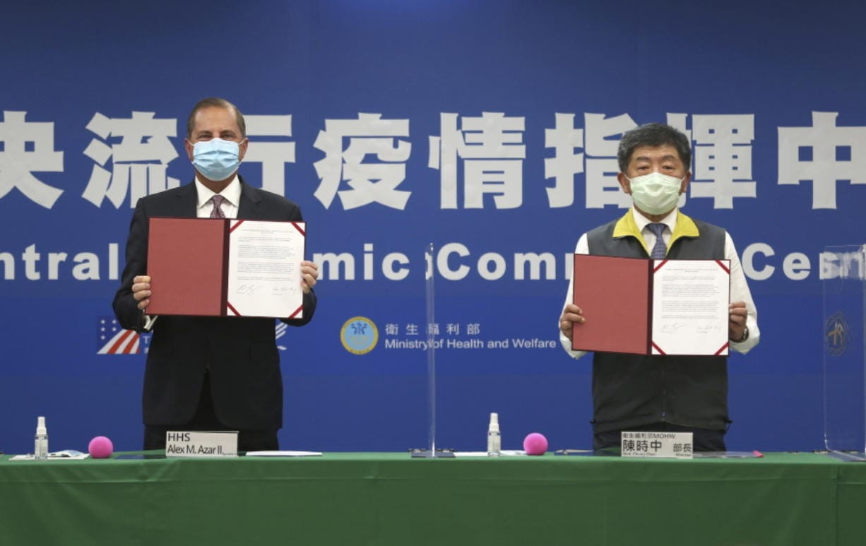U.S. Health and Human Services Secretary Alex Azar, left, and Taiwanese Minister of Health and Welfare Chen Shih-chung pose for a photo during a signing of a memorandum of understanding at the Central Epidemic Command Center in Taipei, Taiwan, Monday, Aug. 10, 2020. Azar arrived in Taiwan on Sunday in the highest-level visit by an American Cabinet official since the break in formal diplomatic relations between Washington and Taipei in 1979.