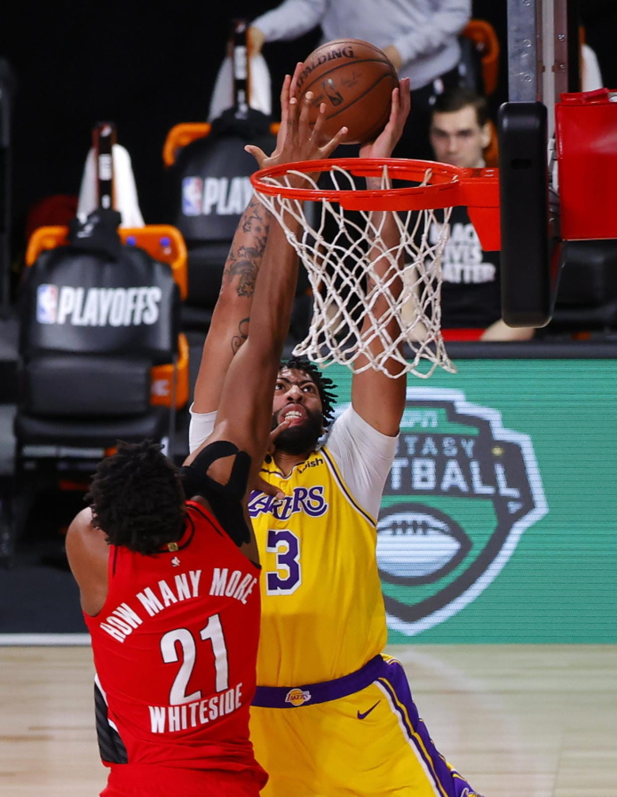 Portland Trail Blazers' Hassan Whiteside (21) blocks a dunk-attempt by Los Angeles Lakers' Anthony Davis (3) during the third quarter of Game 2 of an NBA basketball first-round playoff series, Thursday, Aug. 20, 2020, in Lake Buena Vista, Fla. (Kevin C.