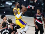 Los Angeles Lakers' LeBron James (23) scores against the Portland Trail Blazers during the second half of an NBA basketball first round playoff game Saturday, Aug. 29, 2020, in Lake Buena Vista, Fla. The Lakers won 131-122 to win the series 4-1.