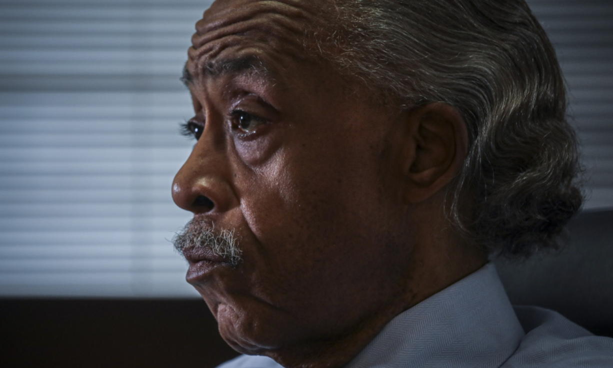 The Rev. Al Sharpton listens during an interview at his office, Thursday, July 30, 2020, in New York. For more than three decades, Sharpton, 65, has been an advocate for Black American families seeking justice in the wake of violence that highlight systemic racism.