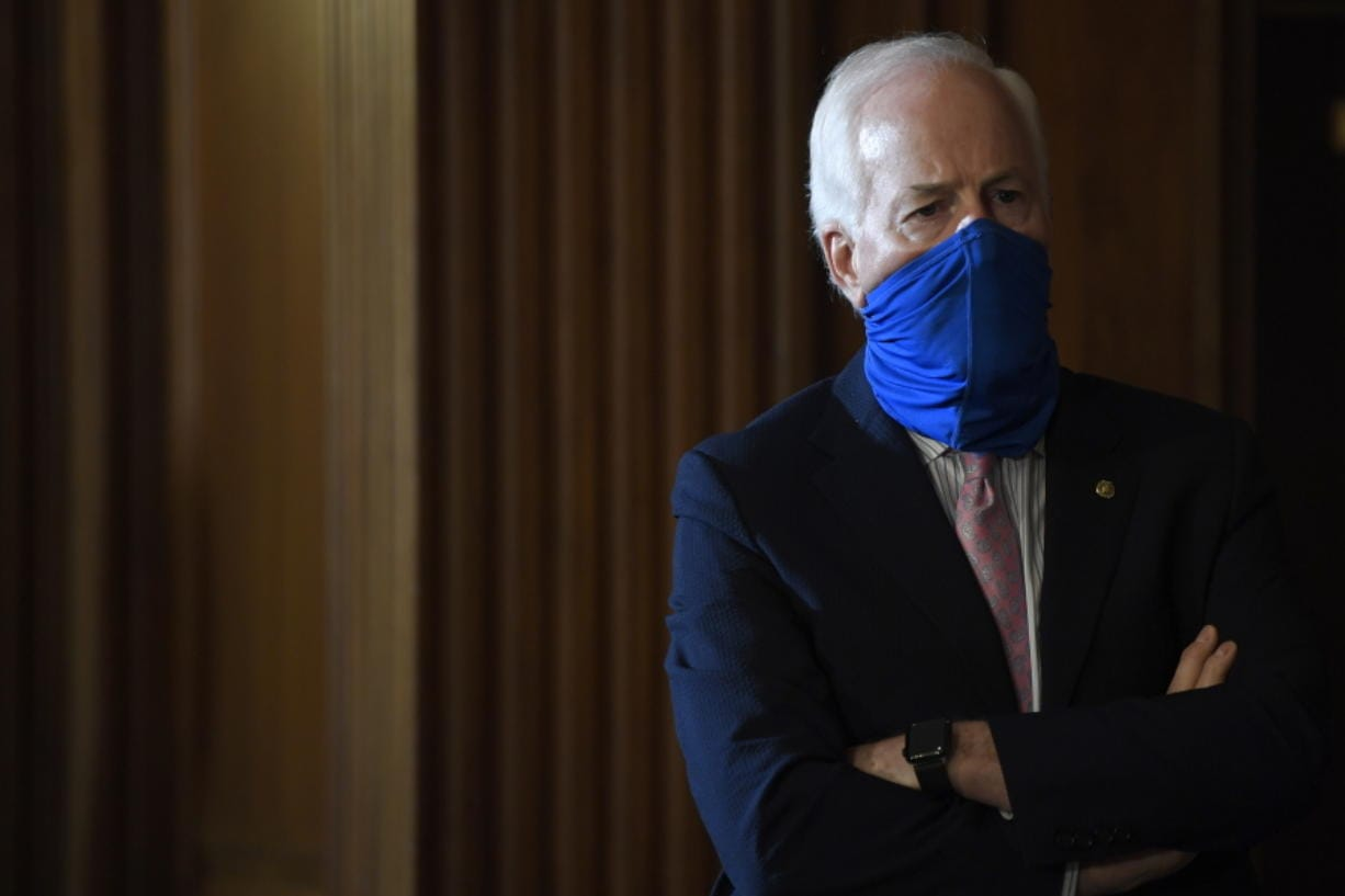 Sen. John Cornyn, R-Texas, listens during a news conference on Capitol Hill in Washington, Monday, July 27, 2020, to highlight the new Republican coronavirus aid package.