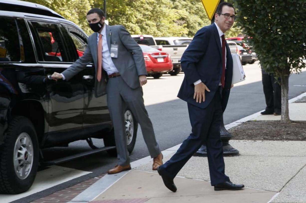 Treasury Secretary Steven Mnuchin arrives for continued negotiations ahead of a meeting, Wednesday, Aug. 5, 2020, on Capitol Hill in Washington.