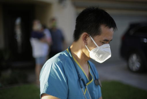 Dr. Tien Vo goes to leave after talking with a family quarantining after they tested positive for the coronavirus Thursday, July 23, 2020, in Calexico, Calif. Vo and members of his clinic bring food to patients that test positive and agree to quarantine.