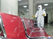"In this undated photo provided on Saturday, Aug. 29, 2020, by the North Korean government, an employee disinfects the inside of Pyongyang Station to protect against the coronavirus in Pyongyang, North Korea. Independent journalists were not given access to cover the event depicted in this image distributed by the North Korean government. The content of this image is as provided and cannot be independently verified. Korean language watermark on image as provided by source reads: ""KCNA"" which is the abbreviation for Korean Central News Agency."