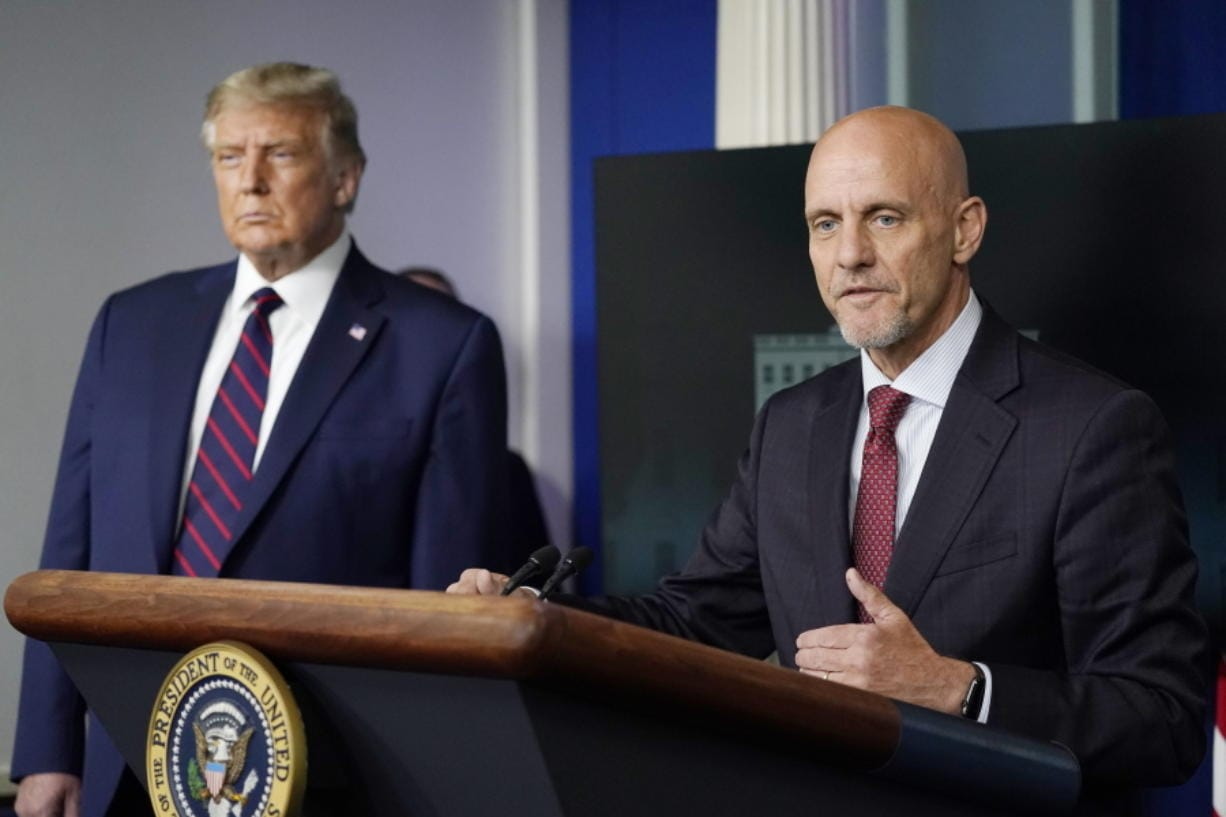 President Donald Trump listens as Dr. Stephen Hahn, commissioner of the U.S. Food and Drug Administration, speaks during a media briefing in the James Brady Briefing Room of the White House, Sunday, Aug.