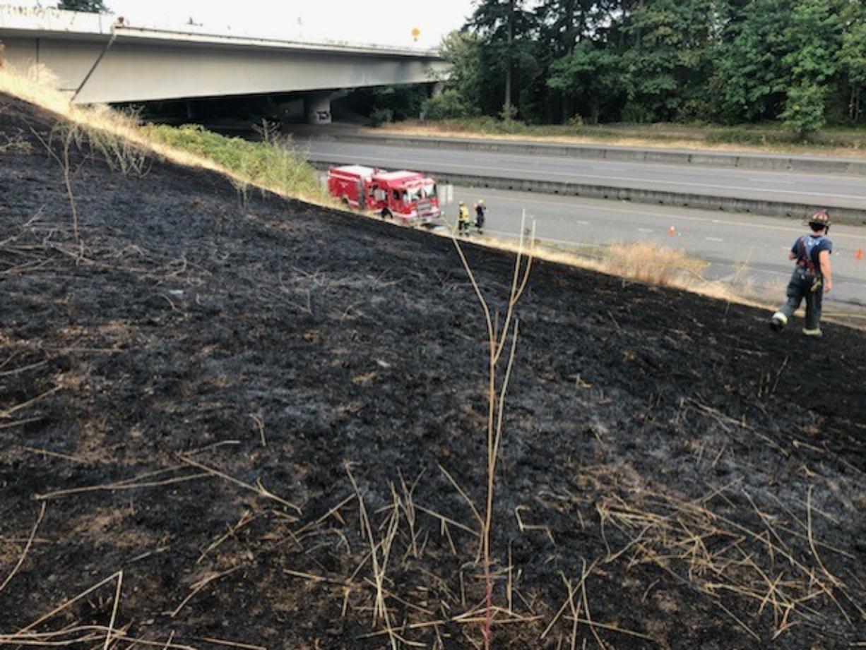 A vehicle fire on state Highway 14 spread to nearby grass Wednesday evening, burning about an acre before being brought under control by the Vancouver Fire Department.