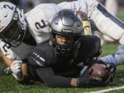 Union's Tobias Merriweather, with ball, is among the top college recruits in Southwest Washington. He and other high school athletes are calling for Governor Jay Inslee and the WIAA to allow fall sports to be played this fall.