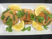 Made with Duke's mayonnaise, fresh breadcrumbs and tarragon, these crab cakes are delicate, creamy and sweet. They are served with tarragon, parsley and lemon wedges.