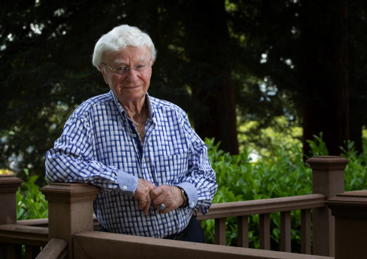 Henry Friedman stands on the deck behind his Mercer Island home Aug. 20. Friedman survived the Holocaust by hiding in an attic with his family. (Ellen M.