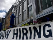"A restaurant displays a ""Now Hiring"" sign amid the coronavirus pandemic, on Aug. 4, 2020 in Arlington, VA."