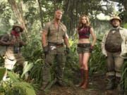 "This file image released by Sony Pictures shows Kevin Hart, from left, Dwayne Johnson, Karen Gillan and Jack Black in ""Jumanji: Welcome to the Jungle."" (Frank Masi/AP files)"