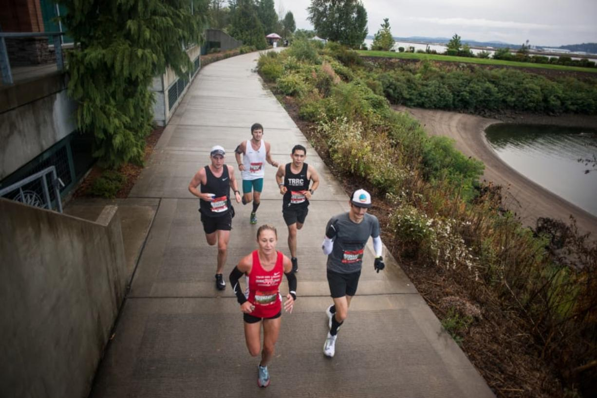 The leaders pack runs in the first half of the inaugural Apple Tree Marathon in Vancouver on Sunday, September 16, 2018.