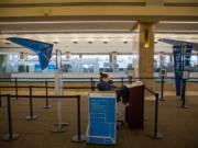 TSA checkpoint at John Wayne Airport, near empty, on March 24, in Santa Ana, Calif. (Jay L.