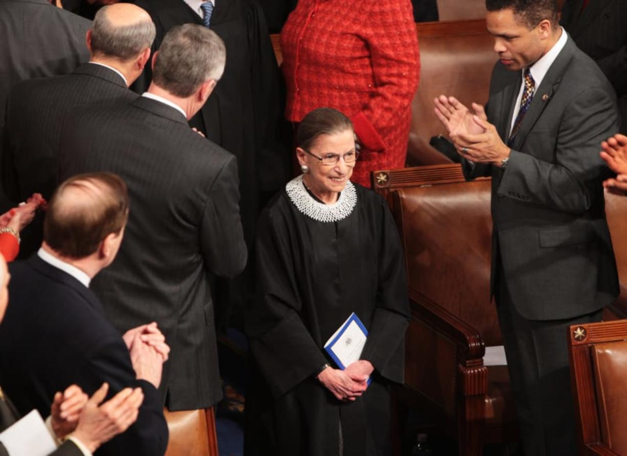 Associate Justice Ruth Bader Ginsburg is cheered as she arrives before President Barack Obama addresses a joint session of Congress on February 24, 2009, in the House of Representatives Chamber in Washington, D.C.