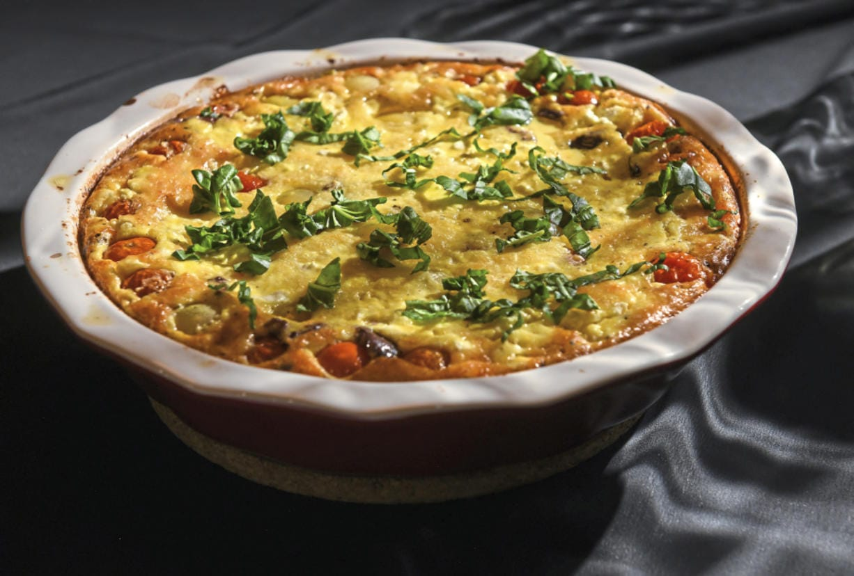 "In her book, ""From the Oven to the Table,"" Diana Henry likens her clafoutis, made with tomato, goat cheese, olives and basil, to a crustless quiche. The soft and light clafoutis does really need accompaniment; it's perfect by itself."