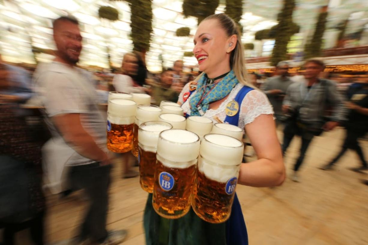 A waitress carries 1-liter mugs of beer during the opening weekend of the 2019 Oktoberfest in Munich, Germany. Here is a soundtrack to listen to if you are celebrating Oktoberfest at home this year.