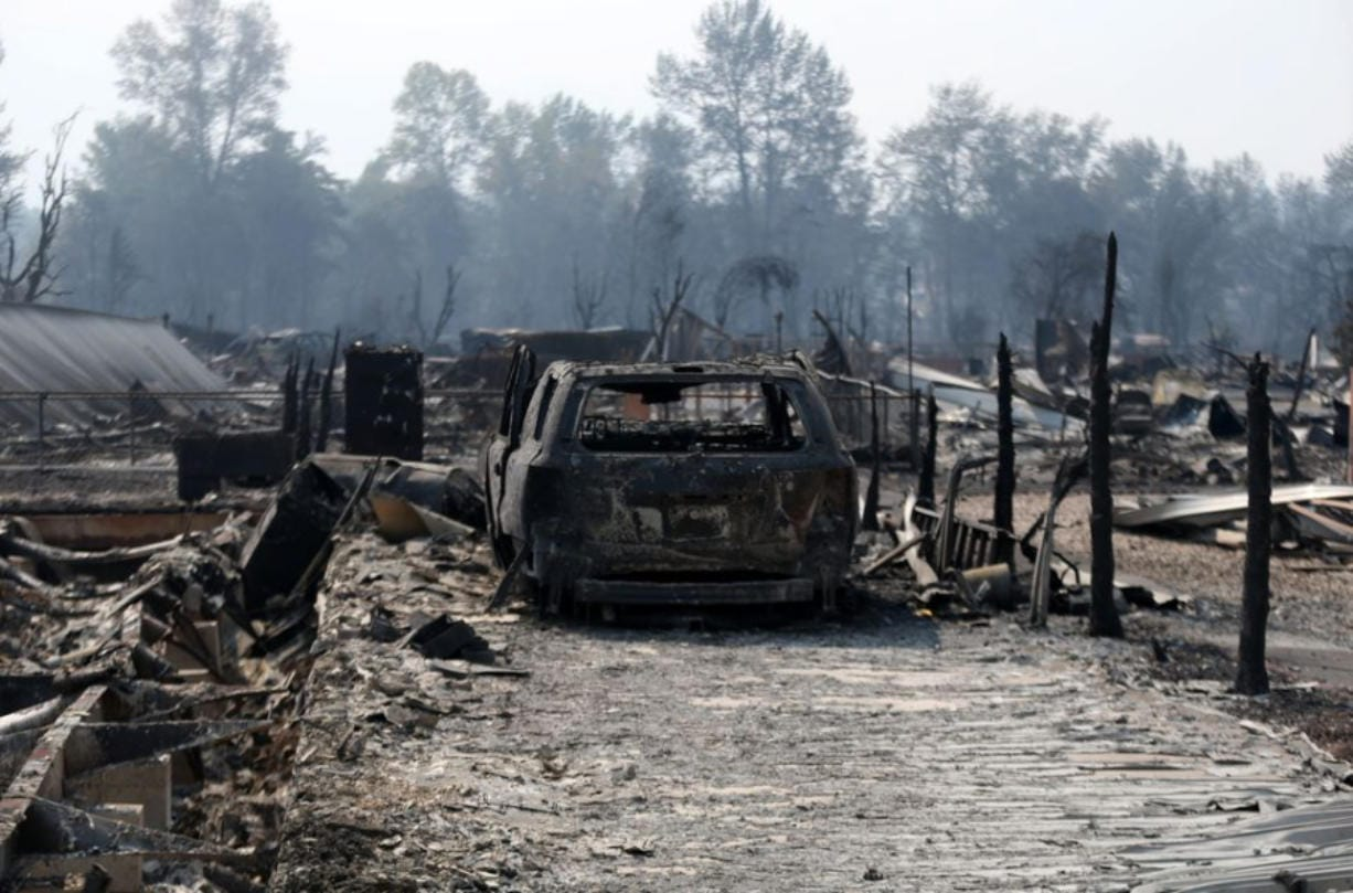 Destruction from the Almeda Fire is shown in Phoenix, Oregon. Thousands have been told to evacuate in southern Oregon as strong winds fed the fire.