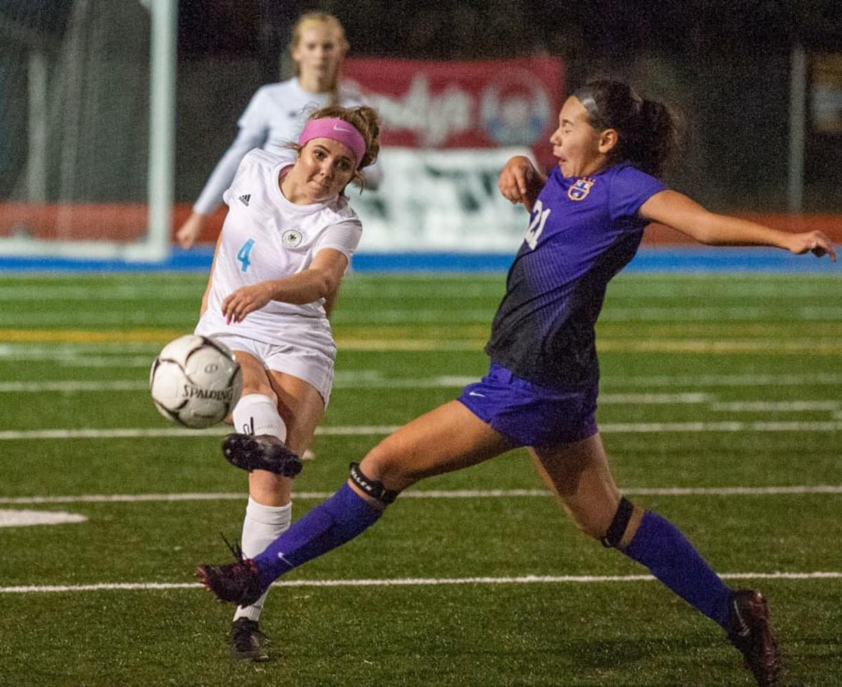 Hockinson's Kati Waggoner makes a pass as Columbia River's Andie Buckley tries to block it.