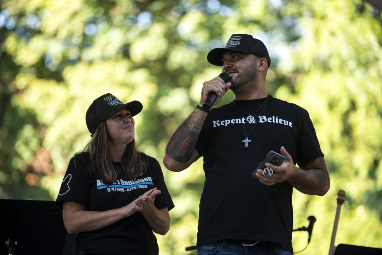 "Michelle Dawson of Battle Ground, left, and Patriot Prayer leader Joey Gibson speak during the memorial to remember Aaron ""Jay"" Danielson who was fatally shot after a pro-Trump rally in Portland last month, at Esther Short Park in Vancouver on September 5, 2020."