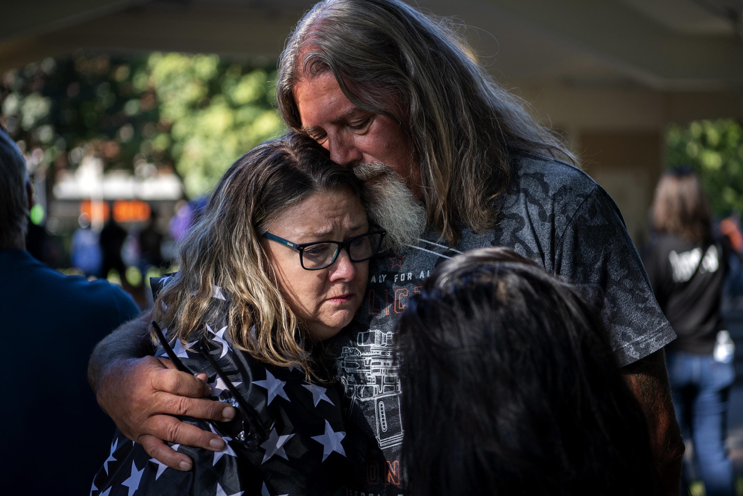 """LaDon Deatherage of Vancouver embraces David Machado after the memorial to remember Aaron """"Jay"""" Danielson who was fatally shot after a pro-Trump rally in Portland last month, at Esther Short Park in Vancouver on September 5, 2020. Deatherage and Machado were both friends with Jay and fellow Patriot Prayer members. """"My heart is heavy,"""" said Detherage. """"These people are called white supremacists and racists, and they are falsely labeled."""" (Alisha Jucevic/The Columbian)"""