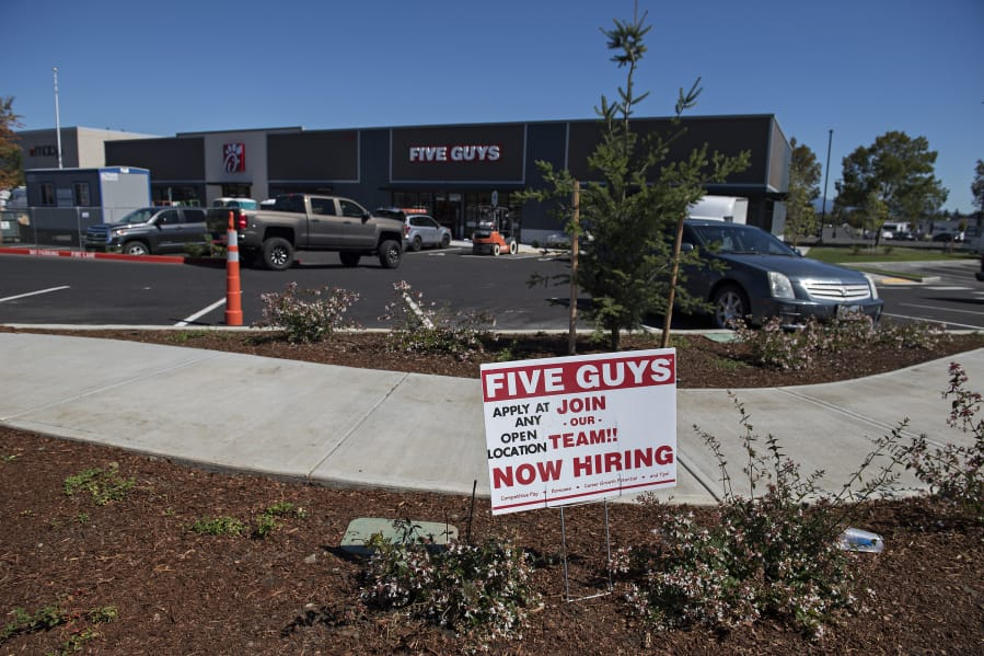 "The new Five Guys Burgers and Fries restaurant at Vancouver Mall appears to be on the verge of opening, with most of the construction equipment removed and ""now hiring"" signs placed out front."