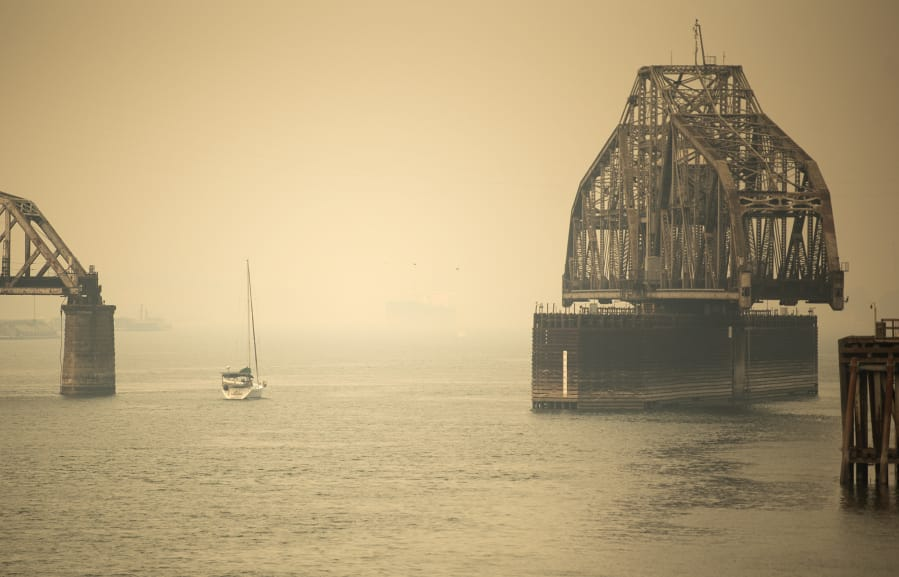 A sailboat makes its way past the railroad bridge Thursday. Clark County air quality is approaching the designation of hazardous, the worst level of air quality, according to the Washington Department of Ecology. Air quality is expected to worsen Friday and continue to be poor throughout the weekend.