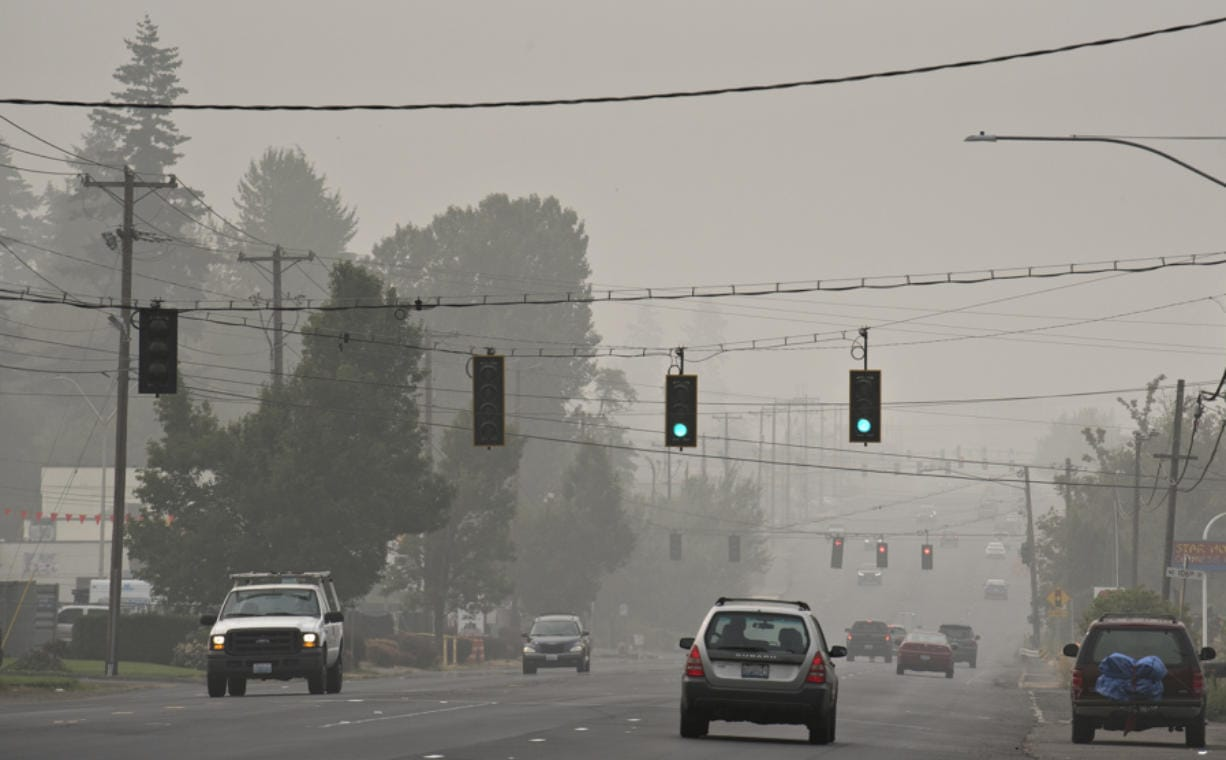 Motorists traveling on Highway 99 navigate thick wildfire smoke as it continues to choke the region.