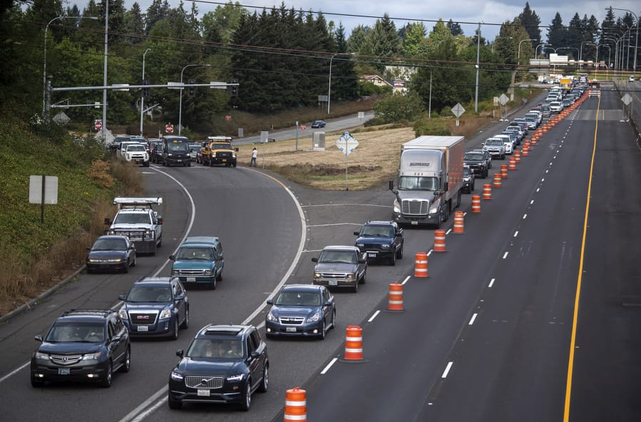Traffic in Vancouver is diverted into one lane Saturday as the Interstate 5 Bridge trunnion repair project begins. The project was delayed due to wildfires throughout the region.