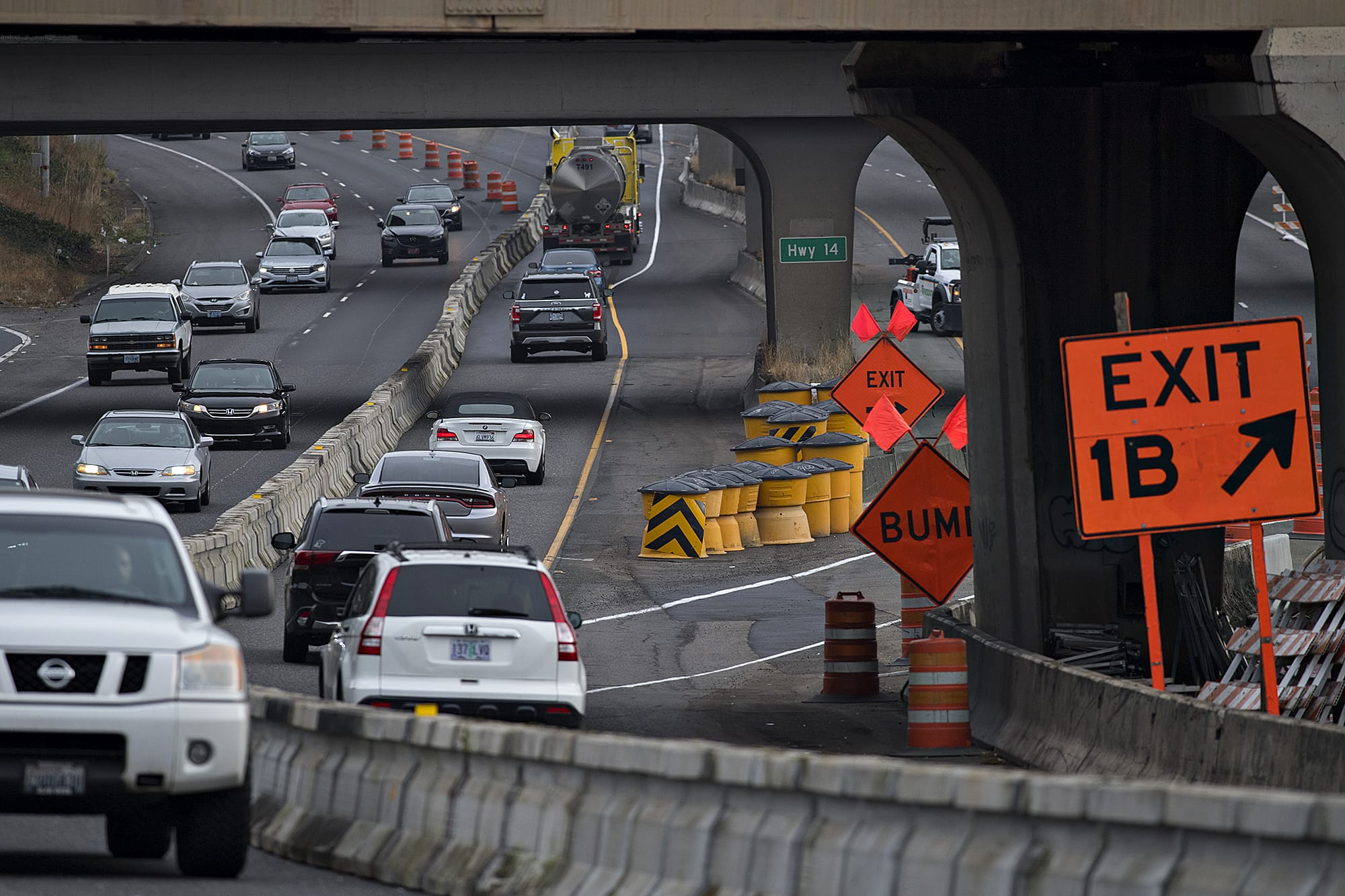 Motorists in the northbound lane of Interstate 5, right, navigate through an altered highway as they enter the Vancouver area Monday morning, Sept. 21, 2020.