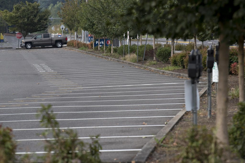 A parking lot at Clark College is nearly empty of cars as students and staff hold classes remotely on Monday morning.