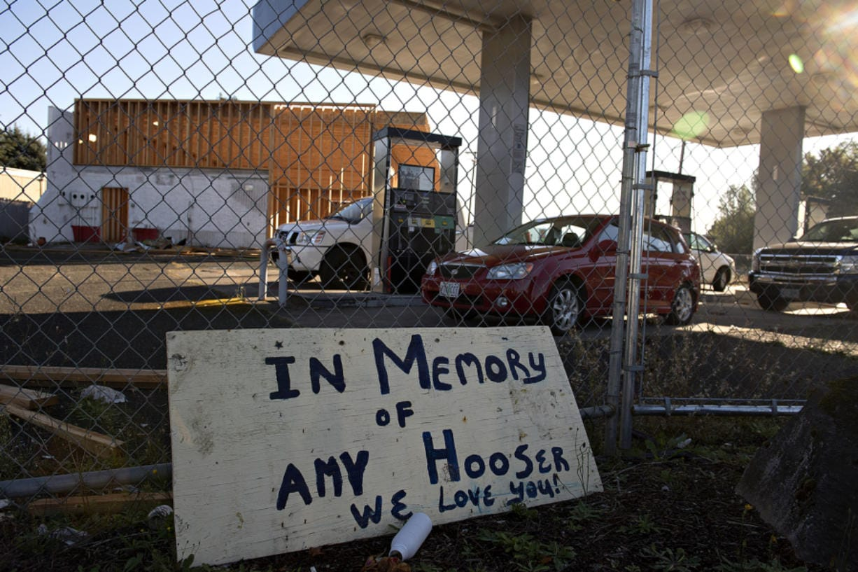 A sign honors the memory of Amy Hooser at the location of the former Sifton Market. Hooser was working an early morning shift at Sifton Market when she was killed in 2017 by Mitchell Heng, who also set the building on fire.