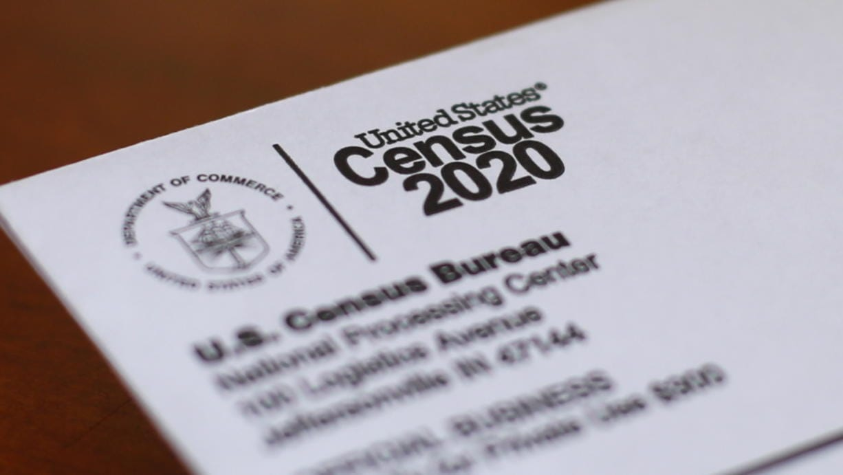 FILE - In this Sunday, April 5, 2020 file photo, An envelope containing a 2020 census letter mailed to a U.S. resident is shown in Detroit. A top lawmaker says the Trump administration is seeking to delay deadlines for the 2020 census because of the coronavirus outbreak. U.S. Rep. Carolyn Maloney said Monday, April 13, 2020 that administration officials also were asking that the timetable for releasing apportionment and redistricting data used to draw congressional and legislative districts be pushed back.