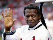 FILE - In this May 17, 2017, file photo, Lou Brock, a member of the St. Louis Cardinals' 1967 World Series championship team, takes part in a ceremony honoring the 50th anniversary of the victory before a baseball game between the Cardinals and the Boston Red Sox in St. Louis. Hall of Famer Brock, one of baseball's signature leadoff hitters and base stealers who helped the Cardinals win three pennants and two World Series titles in the 1960s, has died. He was 81.