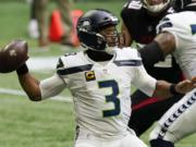 Seattle Seahawks quarterback Russell Wilson (3) works in the p[ocket against the Atlanta Falcons during the first half of an NFL football game, Sunday, Sept. 13, 2020, in Atlanta.