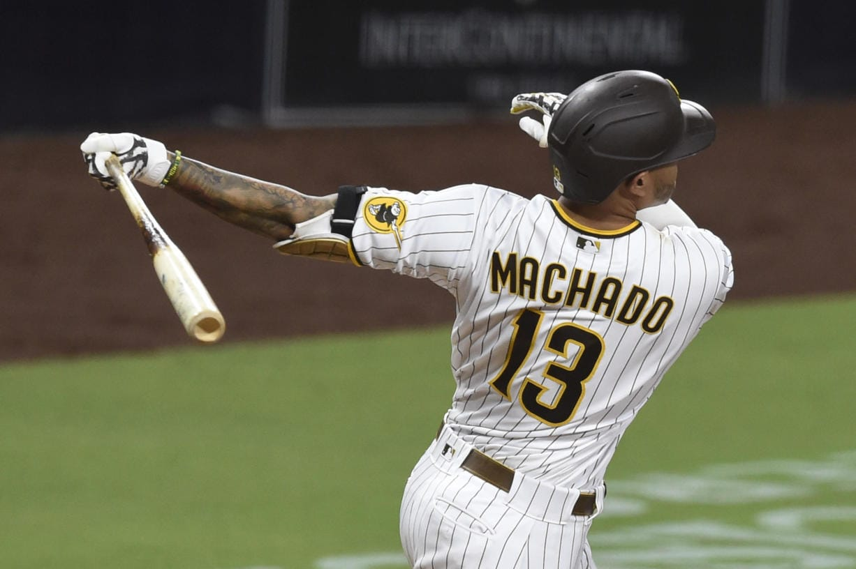 San Diego Padres' Manny Machado hits a solo home run during the ninth inning of the team's baseball game against the Seattle Mariners on Friday, Sept. 18, 2020, in San Diego.