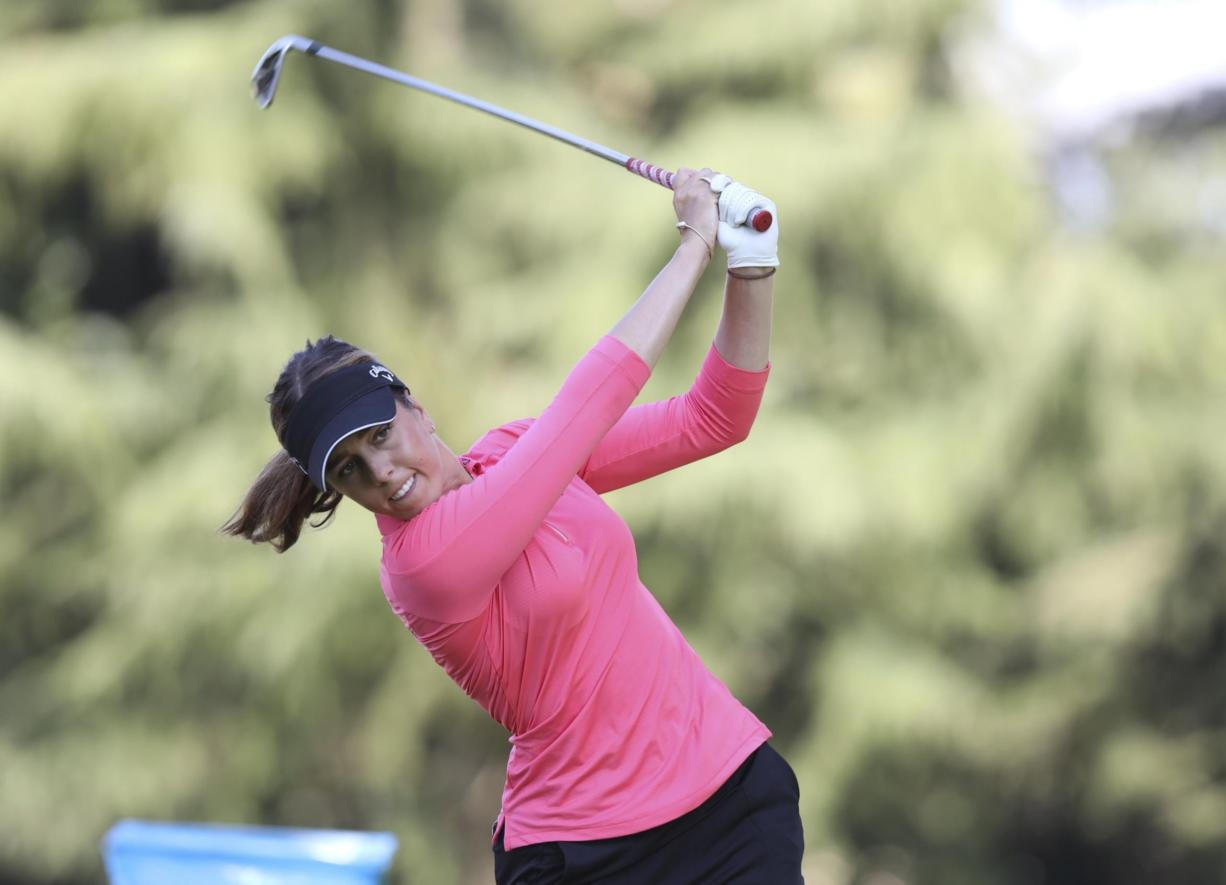 Georgia Hall, of England, watches her tee shot on the 11th hole during the final round of the LPGA Cambia Portland Classic golf tournament in Portland, Ore., Sunday, Sept. 20, 2020.