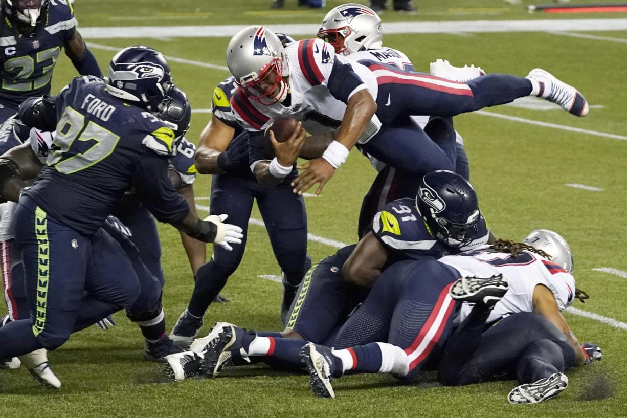 New England Patriots quarterback Cam Newton dives with the ball but is stopped near the goal line as the clock expires in the fourth quarter of an NFL football game against the Seattle Seahawks, Sunday, Sept. 20, 2020, in Seattle. The Seahawks won 35-30.