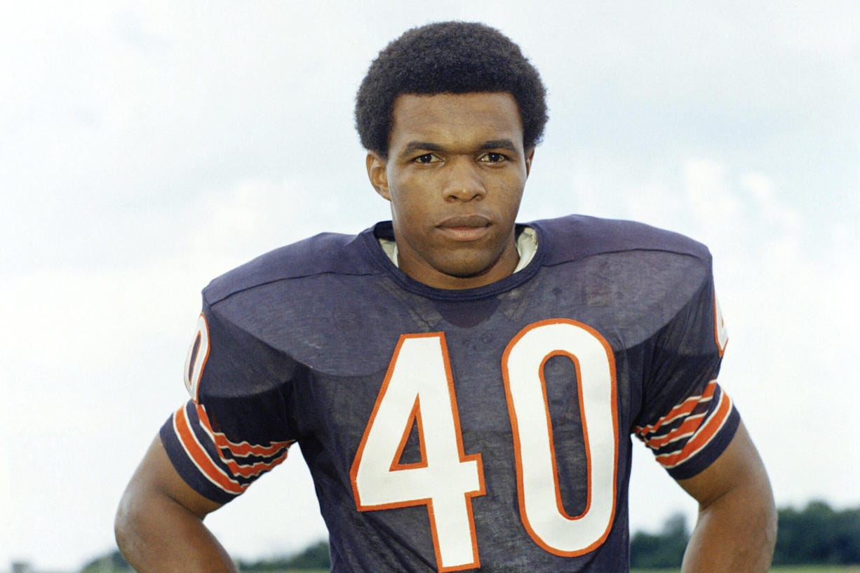 """Chicago Bears football player Gale Sayers in 1970. Hall of Famer Gale Sayers, who made his mark as one of the NFL's best all-purpose running backs and was later celebrated for his enduring friendship with a Chicago Bears teammate with cancer, has died. He was 77. Nicknamed """"The Kansas Comet"""" and considered among the best open-field runners the game has ever seen, Sayers died Wednesday, Sept. 23, 2020, according to the Pro Football Hall of Fame."""