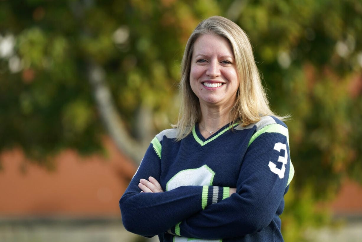 Mindi Wirth, who heads a group called Parents for Safe Schools that is seeking to overturn a sex education requirement for public schools, poses for a photo Sunday, Sept. 27, 2020, in Lynnwood, Wash. Democrats in the famously liberal state say they want to protect young people from sexual abuse, diseases and infections. But the increasingly outnumbered and aggrieved Republicans have taken issue with the content of the standards as they rally for local control. The resulting referendum on the November ballot marks the first time in the country that such a decision on sex ed will be decided by voters.