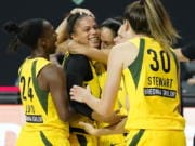 Seattle Storm forward Alysha Clark celebrates her game-winning shot with guard Jewell Loyd (24) and forward Breanna Stewart (30) during the second half of Game 1 of a WNBA basketball semifinal round playoff series against the Minnesota Lynx Tuesday, Sept. 22, 2020, in Bradenton, Fla.