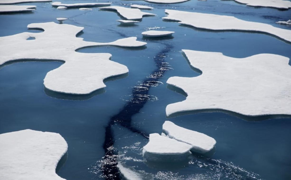 FILE - Sea ice breaks apart as the Finnish icebreaker MSV Nordica traverses the Northwest Passage through the Victoria Strait in the Canadian Arctic Archipelago in a Friday, July 21, 2017 file photo.  The National Snow and Ice Data Center's figures Monday, Sept. 21, 2020 show that sea ice last week was only 1.4 million square miles when it reached its annual low mark for the summer. In the 1980s it was always at least 1 million square miles more.