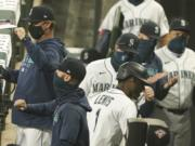 Seattle Mariners' Kyle Lewis (1) is greeted in the dugout after he hit a two-run home run against the Oakland Athletics during the fifth inning of the first baseball game of a doubleheader, Monday, Sept. 14, 2020, in Seattle. (AP Photo/Ted S.