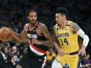The Blazers' Trevor Ariza, left, had a temporary restraining order issued against him, keeping the forward away from his 12-year-old son after the boy's mother alleged that Ariza had physically abused him.