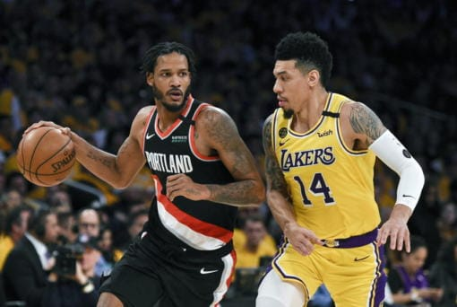 The Blazers' Trevor Ariza, left, had a temporary restraining order issued against him, keeping the forward away from his 12-year-old son after the boy's mother alleged that Ariza had physically abused him. (Kelvin Kuo/Associated Press)